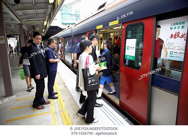 passengers boarding train at sha tin station on the mtr overground line former kcr kowloon canton railway hong kong hksar china asia