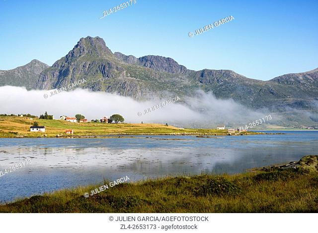 Norway, Nordland, Lofoten islands, Flakstadoy island, Ramberg, Flakstad area, houses and fjord