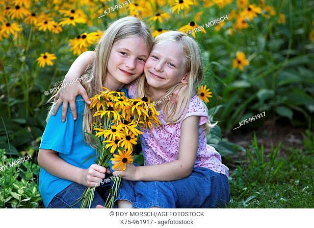 sisters with wildflowers