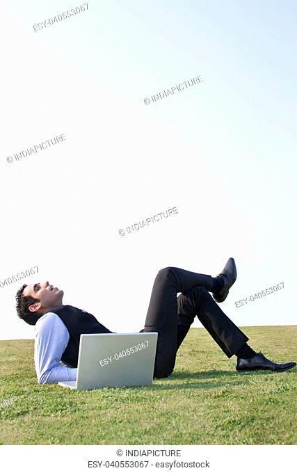 Businessman relaxing outdoors , INDIA , DELHI