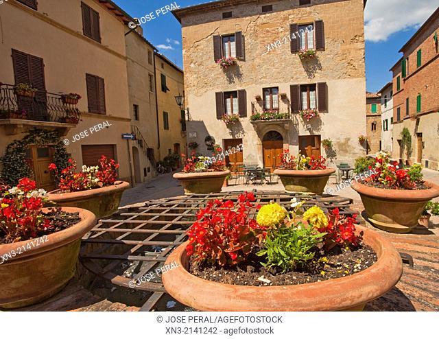 On background restaurant Osteria Sette Di Vino Di Monachini Luciano & C., Piazza di Spagna, Square, Pienza, Val d'Orcia, or Valdorcia, Siena Province, Tuscany