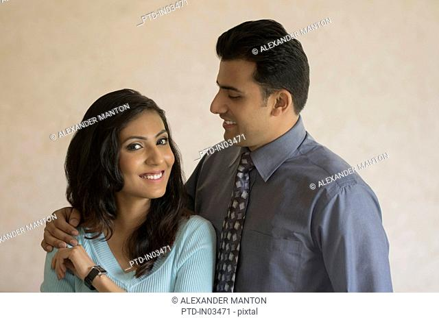India, Portrait of man looking at woman