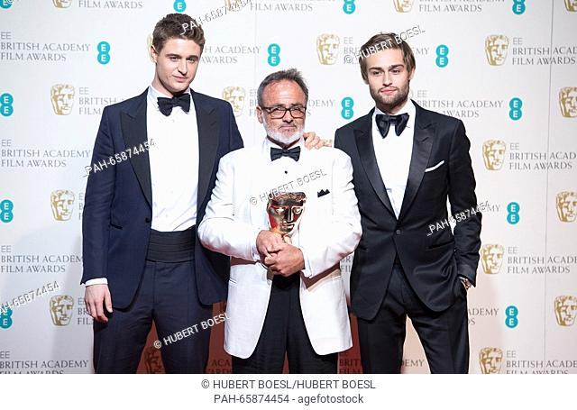 Actors Max Irons (l) and Douglas Booth (r) pose with production designer Colin Gibson in the press room of the EE British Academy Film Awards, BAFTA Awards