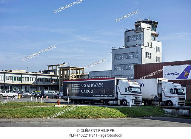 Cargo trucks in front of the Ostend-Bruges International Airport / Internationale Luchthaven Oostende-Brugge, Belgium