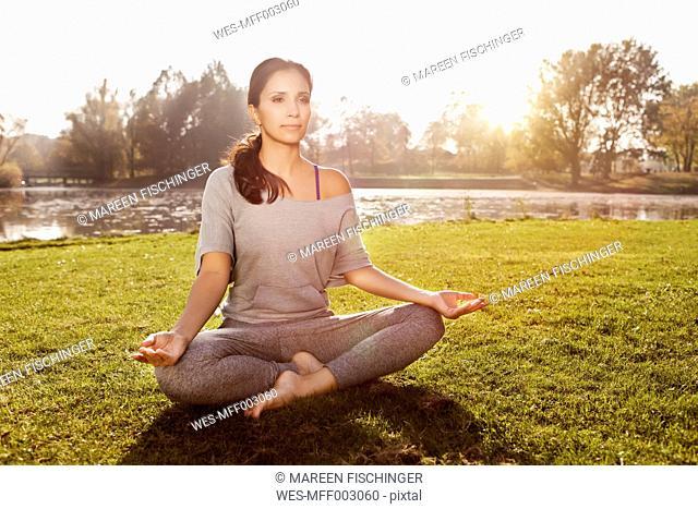 Woman relaxing in Lotus yoga pose