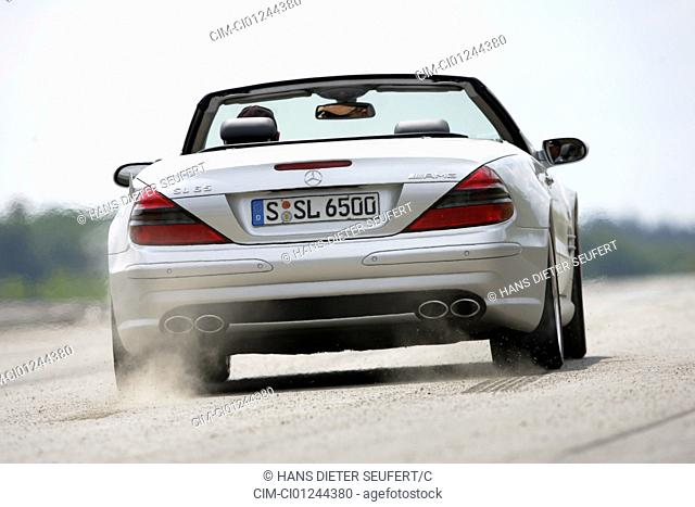 Car, Mercedes SL 65 AMG, Convertible, model year 2004-, silver, Tuning, open top, driving, diagonal from the back, rear view, test track