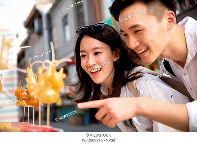 Happy couples see sugar in the street