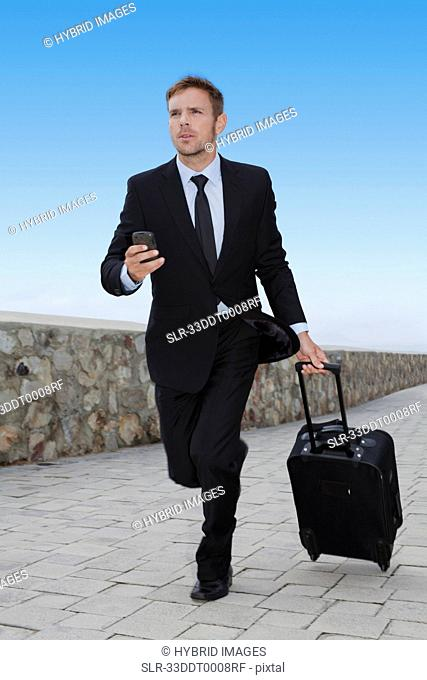Businessman running with luggage