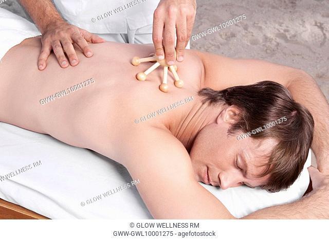 Man receiving acupressure treatment
