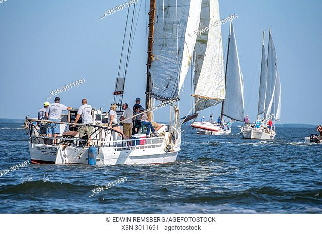 Group of people sailing on traditional Skipjack ship on the Chesapeake Bay during the annual Deal Island Skipjack Races, Deal Island, Maryland. USA