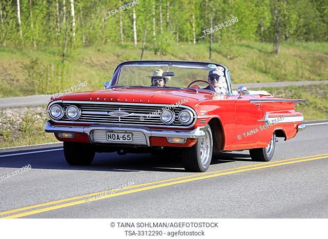 Salo, Finland. May 18, 2019. Classic 1960s red Chevrolet Impala Convertible on the road on Salon Maisema Cruising 2019. Credit: Taina Sohlman/agefotostock