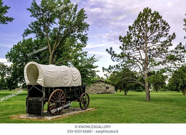 Rustic covered wagon and a park
