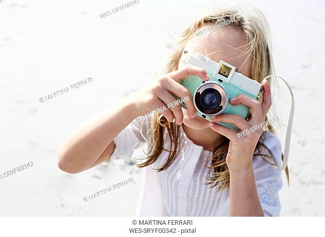 Little girl taking pictures with her camera