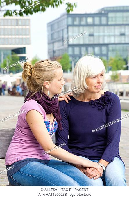 Young girl consoling her mother