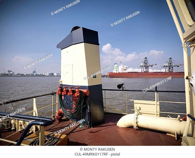 Tugboat docked in urban harbor