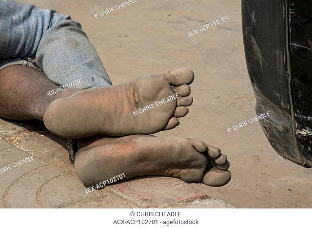 Bare feet of man, New Delhi, India