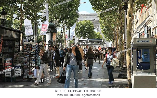People walking on the Champs Elysees in Paris