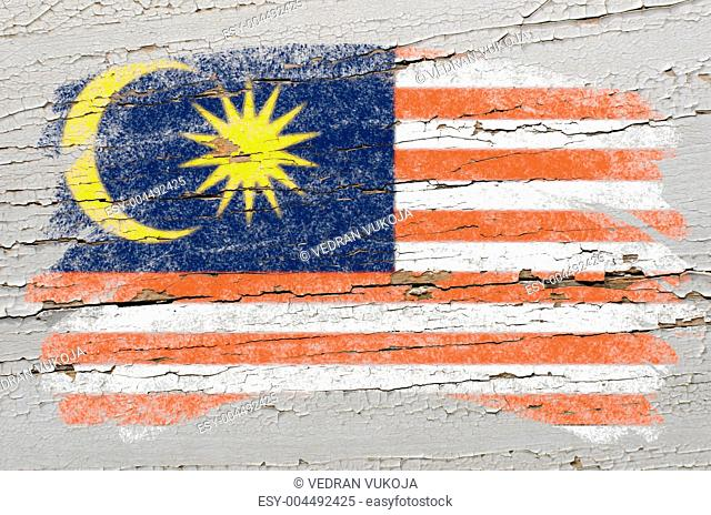 flag of Malaysia on grunge wooden texture painted with chalk