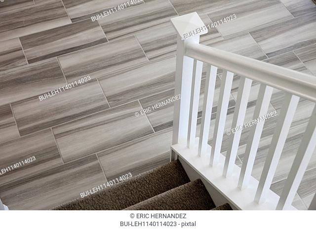 Close-up of stairs with tiled floor at home