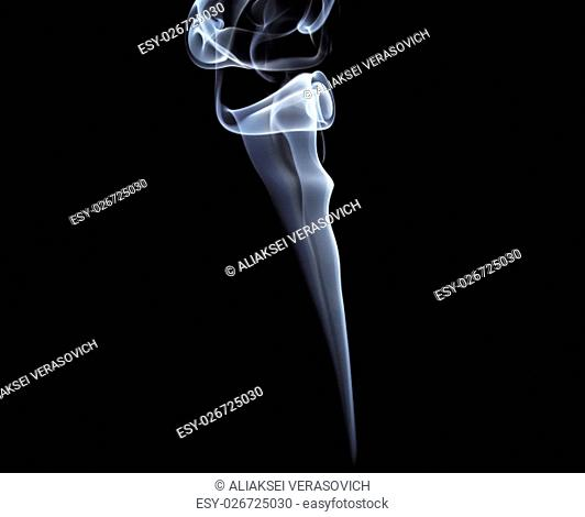 Photo of abstract smoke swirls on black background. Studio shot