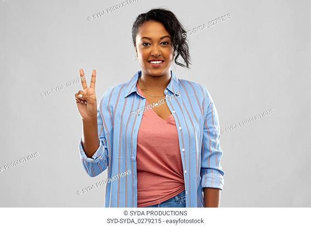 happy african american woman showing peace