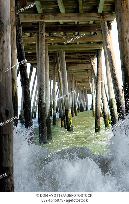 raging surf under the pier in Kill Devil Hills, NC, USA