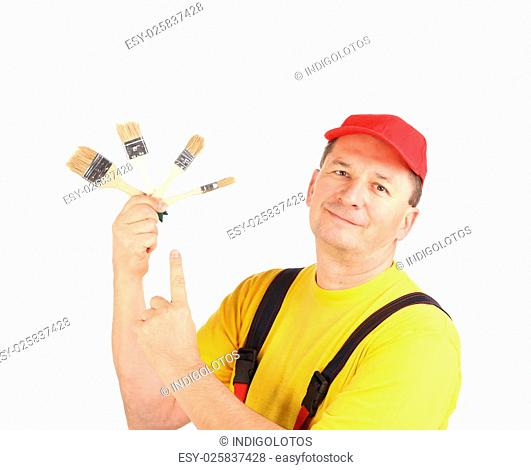 Worker shows painting brushes. Isolated on a white background