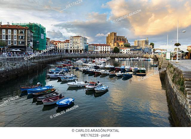 The lighthouse and the church of Santa Maria in the beautiful port of Castro Urdiales, Cantabria, before sunrise