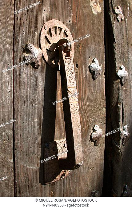 Old knocker on wooden door
