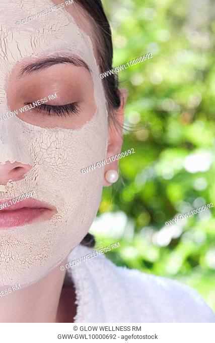 Woman with facial mask on her face