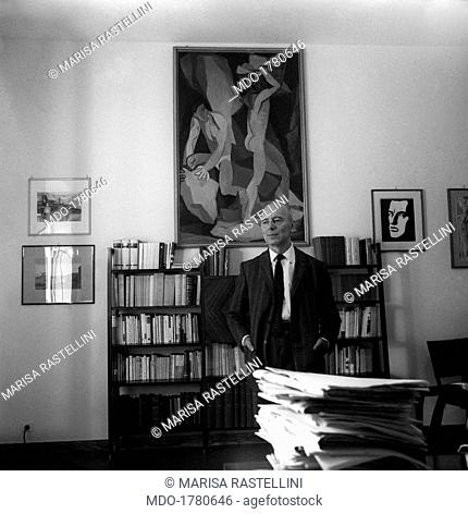 Giancarlo Pajetta posing in his study. Italian politician and partisan Giancarlo Pajetta posing in his study in via delle Botteghe Oscure in front of the...
