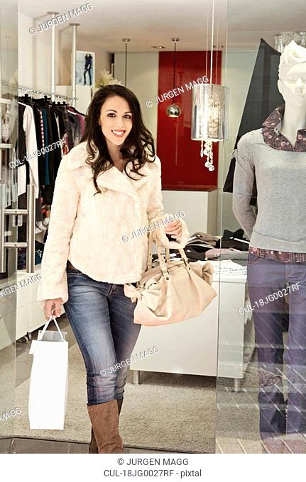 A woman walking out of a boutique