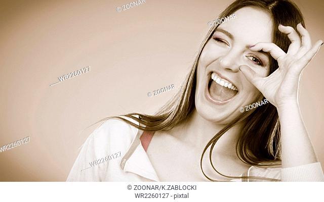 woman looking through imaginary binocular