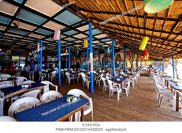 Tables and chairs in a restaurant, Curlies Bar and Restaurant, Anjuna, North Goa, Goa, India