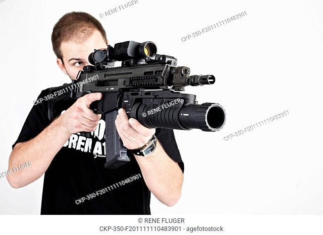 New assault rifle, carabine, automatic weapon, type CZ 805 BREN A2 with attached under-barrel grenade launcher CZ 805 G and daytime conditions riflescope...