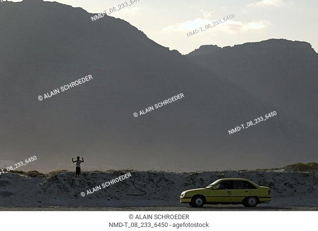 Car in front of a mountain, Muizenberg, False Bay, Cape Town, Western Cape Province, South Africa