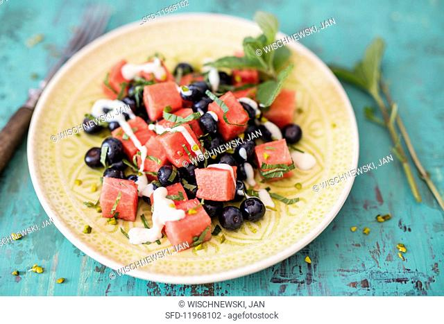 Watermelon with blueberries, mint, pistachios and silken tofu cream