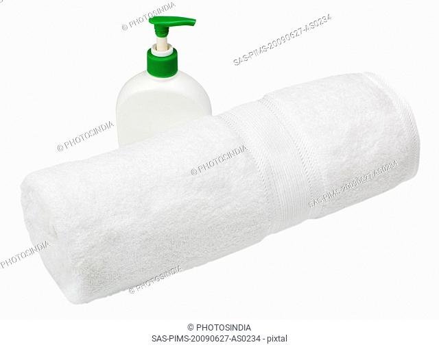 Close-up of a towel with a soap dispenser