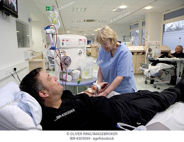 Patient and nurse during outpatient dialysis in the dialysis center of the Dominikus Krankenhaus hospital, Heerdt, North Rhine-Westphalia, Germany