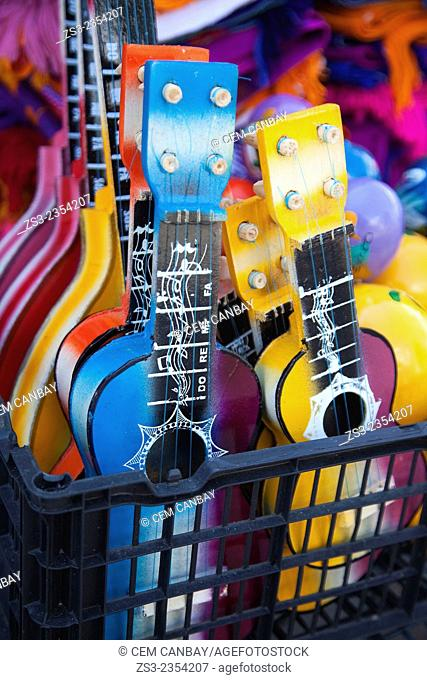 Colorful guitars at the market stall in town center, Isla Mujeres, Cancun, Quintana Roo, Yucatan Province, Mexico, Central America