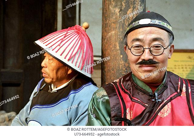 Chinese men in traditional cloth in the beautiful old city of Ping Yao, Shanxi, China