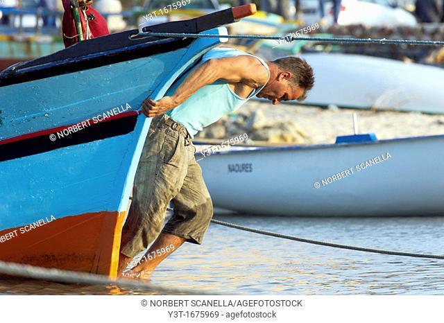 North Africa, Tunisia, Cape Bon, Hammamet. Fisherman returning his boat