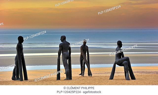 Players, sculptures by artist Michal Gabriel on the beach during Beaufort04 at de Panne, Belgium