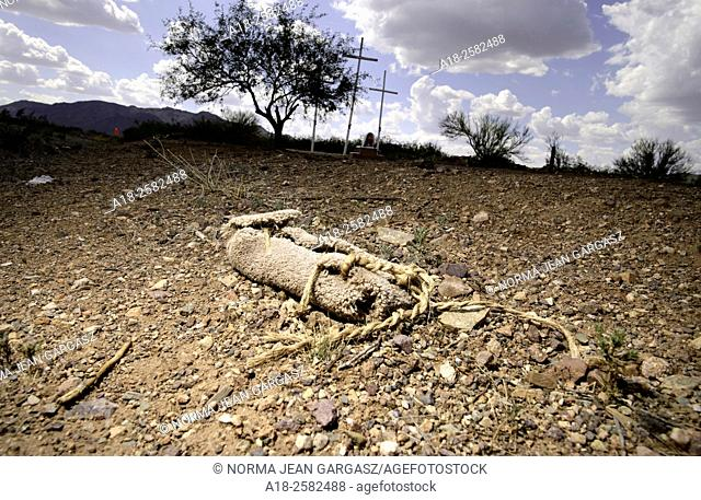 A carpet shoe or shoe covering that is typically used by smugglers on foot to disrupt tracking by law enforcement sits along reservation Route 30 in the Sonoran...