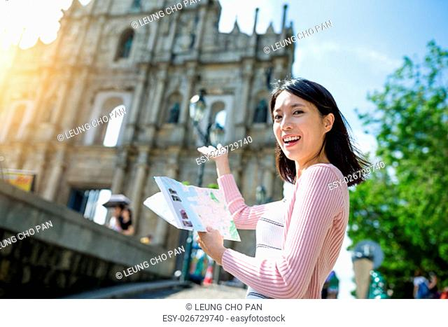 Woman holding city guide in Macao city