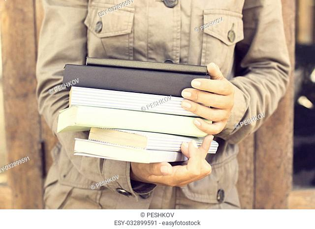Girl with pack of books