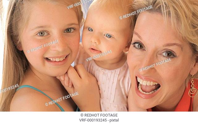 Close up of grandmother and two granddaughters together