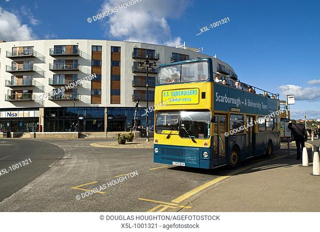 North Bay SCARBOROUGH NORTH YORKSHIRE Open top bus on North Bay promenade The Sands Sea front apartments