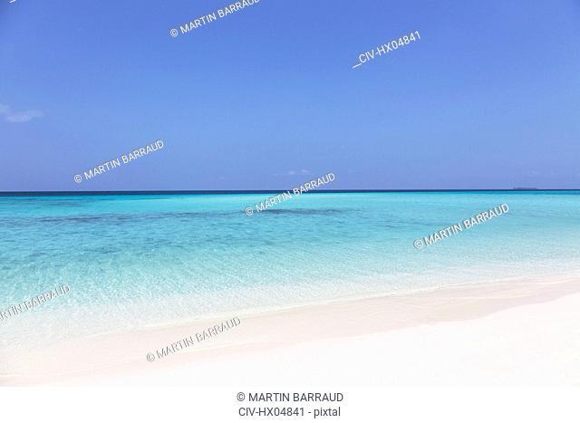 Tranquil, sunny blue ocean beach, Maldives, Indian Ocean