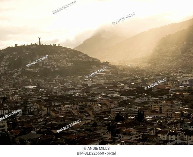 Fog over mountain cityscape